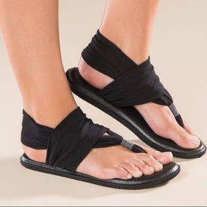 Black Sanuk yoga mat sling sandals
